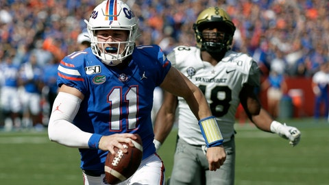 <p>               Florida quarterback Kyle Trask (11) runs past Vanderbilt linebacker Andre Mintze for a 9-yard touchdown during the first half of an NCAA college football game, Saturday, Nov. 9, 2019, in Gainesville, Fla. (AP Photo/John Raoux)             </p>