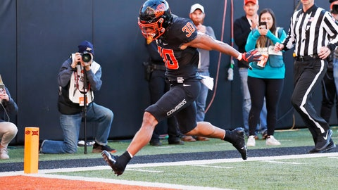 <p>               Oklahoma State running back Chuba Hubbard (30) leaps into the end zone with a touchdown in the second half of an NCAA college football game against TCU in Stillwater, Okla., Saturday, Nov. 2, 2019. (AP Photo/Sue Ogrocki)             </p>