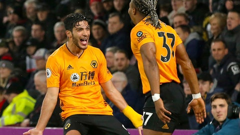 <p>               Wolverhampton Wanderers' Raul Jimenez, left,  celebrates scoring his side's second goal of the game with Adama Traoreduring the English Premier League soccer match between Bournemouth and Wolverhampton Wanderers, at the Vitality Stadium, in Bournemouth, England, Saturday, Nov. 23, 2019. (Mark Kerton/PA via AP)             </p>