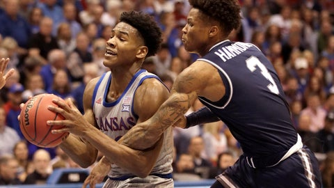 <p>               Kansas guard Ochai Agbaji, left, is fouled by Monmouth guard Deion Hammond (3) during the first half of an NCAA college basketball game in Lawrence, Kan., Friday, Nov. 15, 2019. (AP Photo/Orlin Wagner)             </p>