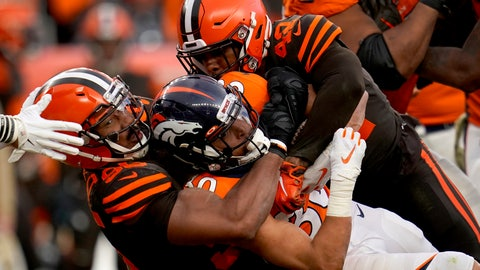<p>               FILE - In this Nov. 3, 2019, file photo, Denver Broncos running back Phillip Lindsay, center, is tackled by Cleveland Browns defensive tackle Sheldon Richardson, left, during the second half of NFL football game, in Denver. While Myles Garrett serves his indefinite NFL suspension for hitting Pittsburgh quarterback Mason Rudolph over the head with a swung helmet, the Cleveland Browns have to find someone to hold down the star defensive end's spot. (AP Photo/Jack Dempsey)             </p>