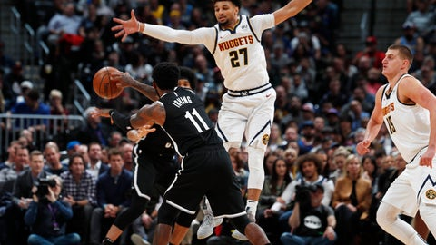 <p>               Brooklyn Nets guard Kyrie Irving, front, passes the ball past Denver Nuggets guard Jamal Murray during the first half of an NBA basketball game Thursday, Nov. 14, 2019, in Denver. (AP Photo/David Zalubowski)             </p>