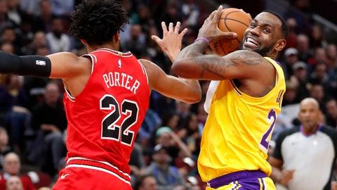 <p>               Los Angeles Lakers' LeBron James, right, drives to the basket past Chicago Bulls' Otto Porter Jr. during the first half of an NBA basketball game Tuesday, Nov. 5, 2019, in Chicago. (AP Photo/Charles Rex Arbogast)             </p>