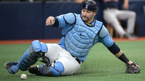 <p>               FILE - In this Sept. 22, 2019, file photo, Tampa Bay Rays catcher Mike Zunino slides to pick up a wild pitch from reliever Andrew Kittredge, allowing the Boston Red Sox's Rafael Devers to score from third base, during the fourth inning of a baseball game in St. Petersburg, Fla. The Rays have agreed to a $4.5 million, one-year contract with Zunino, avoiding arbitration. The deal was announced Monday, Nov. 25, 2019. (AP Photo/Phelan M. Ebenhack, File)             </p>