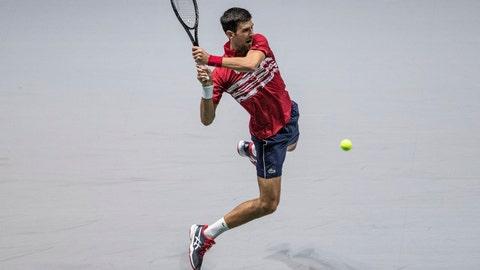 <p>               Serbia's Novak Djokovic returns the ball to Russia's Karen Khachanov during their Davis Cup tennis match in Madrid, Spain, Friday, Nov. 22, 2019. (AP Photo/Bernat Armangue)             </p>