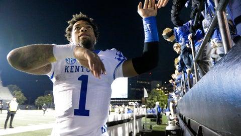 <p>               Kentucky's Lynn Bowden Jr. celebrates with fans after an NCAA college football game against Vanderbilt, Saturday, Nov. 16, 2019, in Nashville, Tenn. (AP Photo/Mark Humphrey)             </p>