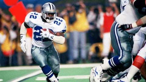 <p>               FILE - In this Jan. 30, 1994, file photo, Dallas Cowboys running back Emmitt Smith (22) runs for short yardage against the Buffalo Bills during Super Bowl XXVIII action at the Georgia Dome in Atlanta. The NFL became a truly booming business in the 1990s, with multi-billion-dollar TV contracts, expansion to 30 teams, and a late-decade wave of new stadiums. Players began to pick up a bigger share of the wealth, with the dawn of unrestricted free agency. The results on the field were largely dominated by the NFC, with Smith and the Cowboys, Steve Young and the San Francisco 49ers, and Brett Favre and the Green Bay Packers enjoying the most success. (AP Photo/Susan Ragan, File)             </p>