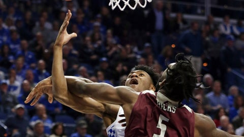<p>               Kentucky's Immanuel Quickley, left, is fouled by Eastern Kentucky's Darius Hicks (5) during the first half of an NCAA college basketball game in Lexington, Ky., Friday, Nov. 8, 2019. (AP Photo/James Crisp)             </p>