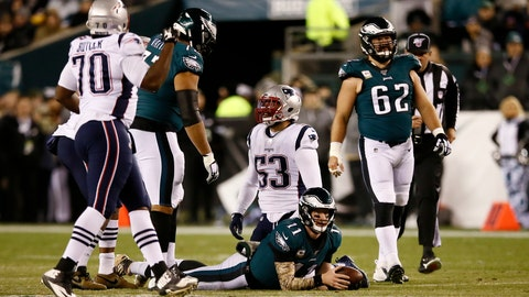 <p>               Philadelphia Eagles' Carson Wentz (11) lies on the field after being tackled by New England Patriots' Kyle Van Noy (53) during the first half of an NFL football game, Sunday, Nov. 17, 2019, in Philadelphia. (AP Photo/Michael Perez)             </p>