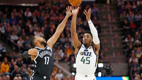 <p>               Utah Jazz guard Donovan Mitchell (45) shoots as Brooklyn Nets guard Garrett Temple (17) defends in the first half during an NBA basketball game Tuesday, Nov. 12, 2019, in Salt Lake City. (AP Photo/Rick Bowmer)             </p>