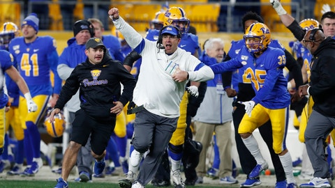 <p>               Pittsburgh coach Pat Narduzzi, center, celebrates with his team as they run onto the field after a fourth-down pass by North Carolina quarterback Sam Howell fell incomplete in the end zone during overtime of an NCAA football game Thursday, Nov. 14, 2019, in Pittsburgh. Pittsburgh won 34-27. (AP Photo/Keith Srakocic)             </p>