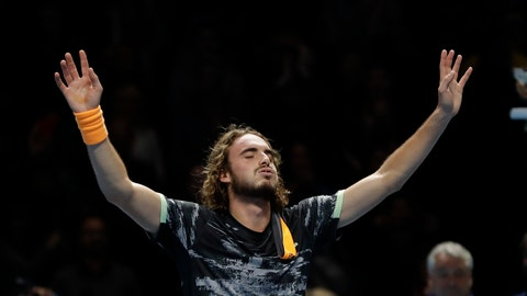 <p>               Stefanos Tsitsipas of Greece reacts after defeating Austria's Dominic Thiem to win their ATP World Finals singles final tennis match at the O2 arena in London, Sunday, Nov. 17, 2019. (AP Photo/Kirsty Wigglesworth)             </p>