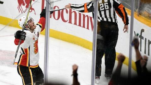 <p>               Calgary Flames left wing Matthew Tkachuk (19) celebrates after scoring against the Nashville Predators in overtime in an NHL hockey game Thursday, Oct. 31, 2019, in Nashville, Tenn. The Flames won 6-5. (AP Photo/Mark Zaleski)             </p>