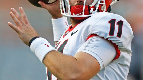 <p>               FILE - In this Oct. 5, 2019, file photo, Georgia quarterback Jake Fromm (11) throws to a receiver during warmups before an NCAA college football game against Tennessee, in Knoxville, Tenn. The SEC hasn't had a quarterback picked in the first round of the NFL draft since Johnny Manziel in 2014, and the league has never had more than one quarterback taken in the first round. It appears that's about to change, as Tua Tagovailoa, Joe Burrow and possibly Jake Fromm could make the next draft the best ever for SEC quarterbacks. (AP Photo/Wade Payne, File)             </p>