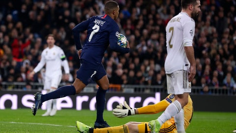 <p>               PSG's Kylian Mbappe, left, celebrates after scoring his side's opening goal during a Champions League soccer match Group A between Real Madrid and Paris Saint Germain at the Santiago Bernabeu stadium in Madrid, Spain, Tuesday, Nov. 26, 2019. (AP Photo/Manu Fernandez)             </p>