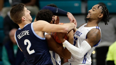<p>               Villanova guard Collin Gillespie (2) and Middle Tennessee State guard Antonio Green (55) struggle for the ball during the second half of an NCAA college basketball game at the Myrtle Beach Invitational in Conway, S.C., Thursday, Nov. 21, 2019. (AP Photo/Gerry Broome)             </p>