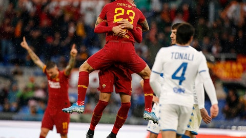 <p>               Roma's Chris Smalling celebrates with his teammate Gianluca Mancini, top center, after scoring his side's opening goal during the Serie A soccer match between Roma and Brescia, at the Olympic stadium stadium in Rome, Sunday, Nov. 24, 2019. (Riccardo Antimiani/ANSA via AP)             </p>