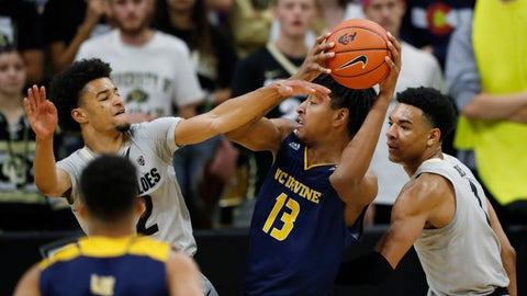 <p>               UC Irvine forward Austin Johnson (13) goes up for a basket between Colorado guards Daylen Kountz, left, and Tyler Bey in the second half of an NCAA college basketball game Monday, Nov. 18, 2019, in Boulder, Colo. (AP Photo/David Zalubowski)             </p>