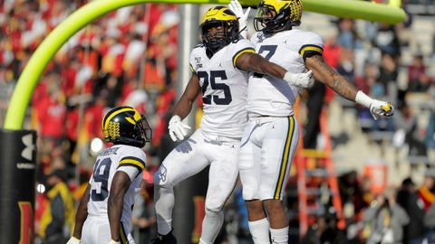 <p>               Michigan running back Hassan Haskins (25) celebrates his touchdown run against Maryland with wide receivers Tarik Black (7) and Mike Sainristil (19) during the second half of an NCAA college football game, Saturday, Nov. 2, 2019, in College Park, Md. Michigan won 38-7. (AP Photo/Julio Cortez)             </p>