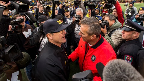 <p>               FILE - In this Nov. 25, 2017, file photo, Michigan head coach Jim Harbaugh, center left, shakes hands with Ohio State head coach Urban Meyer, center right, after Ohio State defeated Michigan 31-20 in an NCAA college football game in Ann Arbor, Mich. Jim Harbaugh's job is safe at Michigan whether he finally beats Ohio State or falls to 0-5, but the timing for a win would provide a boost for college football's winningest program. (AP Photo/Tony Ding, File)             </p>