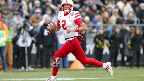 <p>               FILE - In this Nov. 2, 2019, file photo, Nebraska quarterback Adrian Martinez (2) looks for a receiver as he scrambles against Purdue during the first half of an NCAA college football game, in West Lafayette, Ind. Nebraska plays at Maryland on Saturday, Nov. 23. Martinez threw for 220 yards and a touchdown last week against Wisconsin and ran for 89 yards and a score.  (AP Photo/Michael Conroy, File)             </p>
