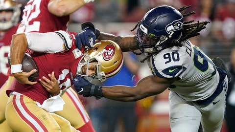 <p>               San Francisco 49ers quarterback Jimmy Garoppolo, left, avoids being sacked by Seattle Seahawks defensive end Jadeveon Clowney (90) during the second half of an NFL football game in Santa Clara, Calif., Monday, Nov. 11, 2019. (AP Photo/Tony Avelar)             </p>