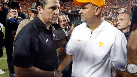 <p>               Tennessee head coach Jeremy Pruitt shakes hands with South Carolina head coach Will Muschamp after an NCAA college football game Saturday, Oct. 26, 2019, in Knoxville, Tenn. Tennessee won 41-21. (AP Photo/Wade Payne)             </p>