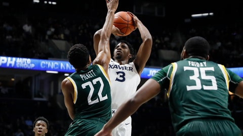 <p>               Xavier's Quentin Goodin (3) shoots over Siena's Jalen Pickett (22) during the first half of an NCAA college basketball game Friday, Nov. 8, 2019, in Cincinnati. (AP Photo/John Minchillo)             </p>
