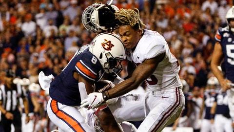 <p>               Alabama defensive back Xavier McKinney (15) loses his helmet as Auburn running back Shaun Shivers (8) runs through him for a touchdown during the second half of an NCAA college football game Saturday, Nov. 30, 2019, in Auburn, Ala. (AP Photo/Butch Dill)             </p>
