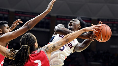 <p>               Connecticut's Sidney Wilson, right, attempts to shoot in the first half of an NCAA college basketball game against Sacred Heart, Friday, Nov. 8, 2019, in Storrs, Conn. (AP Photo/Stephen Dunn)             </p>