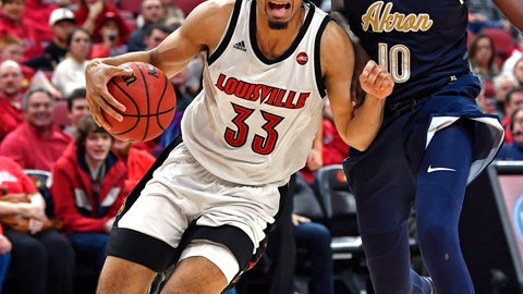 <p>               Louisville forward Jordan Nwora (33) attempts to drive past the defense of Akron center Deng Riak (10) during the second half of an NCAA college basketball game in Louisville, Ky., Sunday, Nov. 24, 2019. (AP Photo/Timothy D. Easley)             </p>