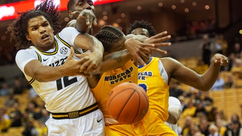 <p>               Missouri's Dru Smith, left, and Jeremiah Tilmon, top, battle Morehead State's Justin Thomas for a rebound during the first half of an NCAA college basketball game Wednesday, Nov. 20, 2019, in Columbia, Mo. (AP Photo/L.G. Patterson)             </p>