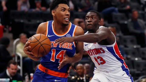 <p>               New York Knicks guard Allonzo Trier (14) looks to pass as Detroit Pistons guard Khyri Thomas (13) defends during the second half of an NBA basketball game, Wednesday, Nov. 6, 2019, in Detroit. (AP Photo/Carlos Osorio)             </p>