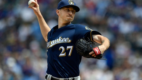 <p>               FILE - In this Aug 31, 2019, file photo ,Milwaukee Brewers starter Zach Davies delivers a pitch during the first inning of a baseball game against the Chicago Cubs, Saturday,, in Chicago. The San Diego Padres have Davies and outfielder Trent Grisham from the Brewers in exchange for left-hander Eric Lauer, infielder Luis Urías and a player to be named later or cash considerations, the Padres announced Wednesday, Nov. 27, 2019. (AP Photo/Paul Beaty, File)             </p>