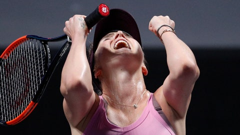 <p>               Elina Svitolina of Ukraine celebrates after defeating Sofia Kenin of the United States in the WTA Finals Tennis Tournament at the Shenzhen Bay Sports Center in Shenzhen, China's Guangdong province, Friday, Nov. 1, 2019. (AP Photo/Andy Wong)             </p>