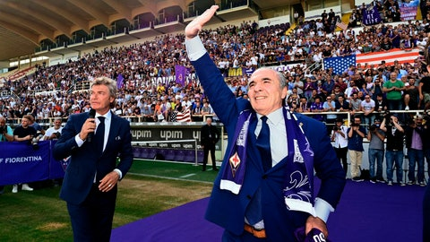 <p>               FILE - In this Friday, June 7, 2019 filer, Rocco Commisso, right, is flanked by former soccer star Giancarlo Antognoni as he waves to supporters at the Artemio Franchi stadium in Florence, Italy. Less than six months into his tenure as Fiorentina owner and president, Rocco Commisso is already starting to grapple with Italy's infamous bureaucracy as he attempts to build a new stadium for the club. First, Commisso's plan to overhaul the existing Stadio Artemio Franchi was rejected by the city committee that protects monuments. Now he is awaiting approval to build a new ground, perhaps near the city's airport. (Claudio Giovannini/ANSA via AP, File )             </p>