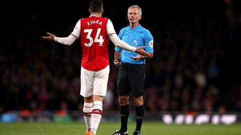 <p>               Arsenal's Granit Xhaka speaks to referee Martin Atkinson during the English Premier League soccer match at the Emirates Stadium, London, Sunday Oct. 27, 2019. (Nigel French/PA via AP)             </p>