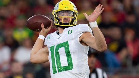 <p>               Oregon quarterback Justin Herbert throws a pass during the first half of an NCAA college football game against Southern California, Saturday, Nov. 2, 2019, in Los Angeles. (AP Photo/Kyusung Gong)             </p>