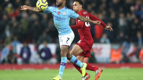 <p>               Manchester City's Raheem Sterling, left, challenges for the ball with Liverpool's Dejan Lovren during the English Premier League soccer match between Liverpool and Manchester City at Anfield stadium in Liverpool, England, Sunday, Nov. 10, 2019. (AP Photo/Jon Super)             </p>