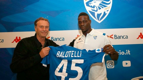 """<p>               FILE - In this Monday, Aug. 19, 2019 file photo, Brescia's president Massimo Cellino, left, holds a soccer jersey with soccer player Mario Balotelli during a press conference in Brescia, Italy. Brescia President Massimo Cellino has made an apparently racist remark about his own club's forward Mario Balotelli. The 29-year-old Balotelli has struggled since returning to Serie A with Brescia, his hometown club, and was dropped from the weekend's match following a dispute with coach Fabio Grosso. Asked about Balotelli on Monday, Cellino said: """"He's black, what can I say, he's working on clearing himself but he's having a lot of difficulty."""" (Filippo Venezia/ANSA via AP, File )             </p>"""