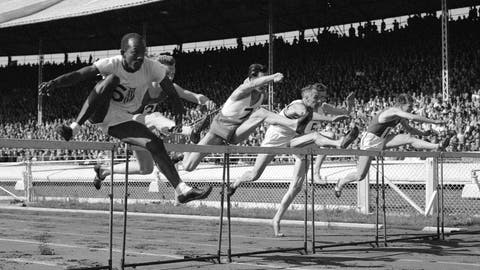 <p>               FILE - In this June 1949 photo, competitors jump in the 120-yard international hurdles during the British Games, incorporating International Athletics Match, in London. The competitors are P Van de Sype of Belgium (1); A. Marie of France (no.3); Donald Finlay of Britain (4); E. Arneberg, of Norway (5); Harrison Dillard, left, of the United States, and G. V. D. Hoeven, of Holland (7). Dillard won the event in 14.4 seconds, followed by A. Marie in second place and Finlay in third. Dillard, the only Olympic runner to win gold medals in both the sprints and high hurdles, has died. He was 96. Longtime friend Ted Theodore said Dillard died Friday, Nov. 15, 2019, at the Cleveland Clinic after a fight with stomach cancer. The 1955 Sullivan Award winner as the nation's outstanding amateur athlete, Dillard was the oldest living U.S. Olympic champion. (AP Photo, File)             </p>