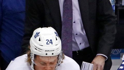 <p>               Toronto Maple Leafs head coach Mike Babcock stands behind Kasperi Kapanen (24) during the first period of an NHL hockey game against the Toronto Maple Leafs in Pittsburgh, Saturday, Nov. 16, 2019. The Penguins won 6-1. (AP Photo/Gene J. Puskar)             </p>