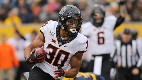 <p>               Oklahoma State's Chuba Hubbard (30) carries the ball during the second quarter of an NCAA college football game against West Virginia in Morgantown, W.Va., on Saturday, Nov. 23, 2019. (AP Photo/Chris Jackson)             </p>
