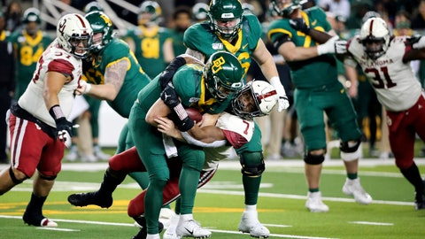 <p>               Baylor quarterback Charlie Brewer, left center, is sacked by Oklahoma defensive lineman Ronnie Perkins, right center, during the second half of an NCAA college football game in Waco, Texas, Saturday, Nov. 16, 2019. Oklahoma won 34-31. (AP Photo/Ray Carlin)             </p>