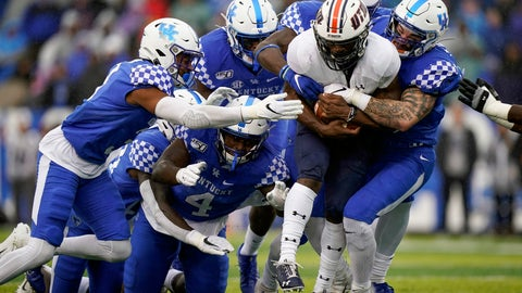 <p>               UT Martin running back Jaimiee Bowe (5) is tackled by a group of Kentucky defenders in the first half of an NCAA college football game against UT Martin, Saturday, Nov. 23, 2019, in Lexington, Ky. (AP Photo/Bryan Woolston)             </p>
