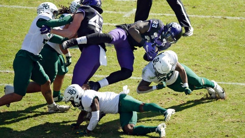 <p>               TCU running back Sewo Olonilua (33) is tackled by Baylor safety Will Williams (33) during the first half of an NCAA college football game, Saturday, Nov. 9, 2019, in Fort Worth, Texas. (AP Photo/Ron Jenkins)             </p>