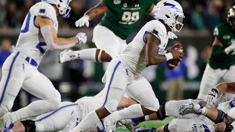 <p>               Air Force quarterback Donald Hammond III, front, runs for a short gain with Colorado State defensive lineman Ellison Hubbard in pursuit in the first half of an NCAA football game Saturday, Nov. 16, 2019 in Fort Collins, Colo. (AP Photo/David Zalubowski)             </p>