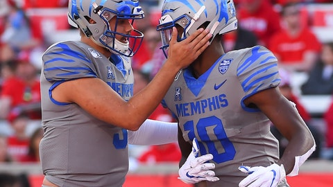 <p>               Memphis wide receiver Damonte Coxie, right, celebrates his touchdown with quarterback Brady White during the first half of an NCAA college football game against Houston, Saturday, Nov. 16, 2019, in Houston. (AP Photo/Eric Christian Smith)             </p>