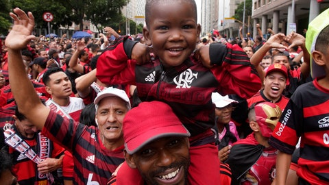<p>               Fans of Brazil's Flamengo cheer as they wait for their arrival in Rio de Janeiro, Brazil, Sunday, Nov. 24, 2019. Flamengo overcame Argentina's River Plate 2-1 in the Copa Libertadores final match on Saturday in Lima to win its second South American title. (AP Photo/Ricardo Borges)             </p>