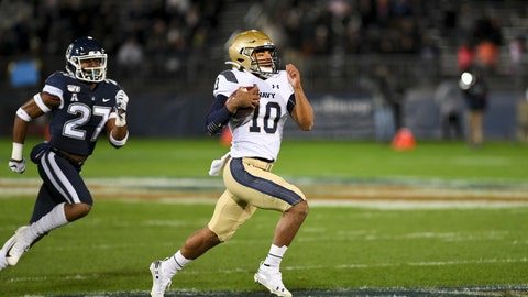 <p>               Navy quarterback Malcolm Perry (10) takes the ball in for Navy's first touchdown during the first half of an NCAA college football game against Connecticut on Friday, Nov. 1, 2019, in East Hartford, Conn. (AP Photo/Stephen Dunn)             </p>